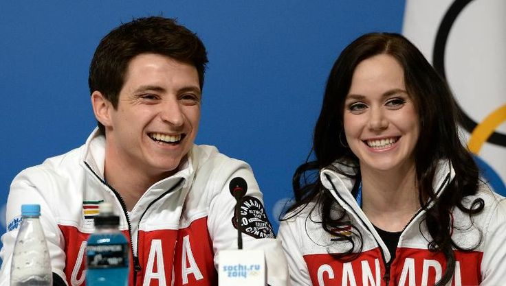 Tessa Virtue and Scott Moir speak at a press conference with Canada's figure skating team on February 6, 2014, in Sochi