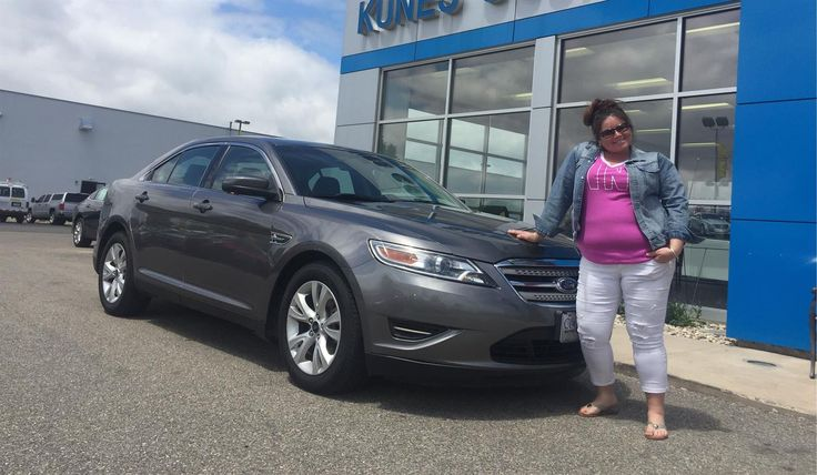 """Tina and Jon, wishing you many """"Miles of Smiles"""" in your 2012 FORD TAURUS!  All the best, Kunes Country Chevrolet Cadillac of Delavan and JOHNNY FERNANDZ."""