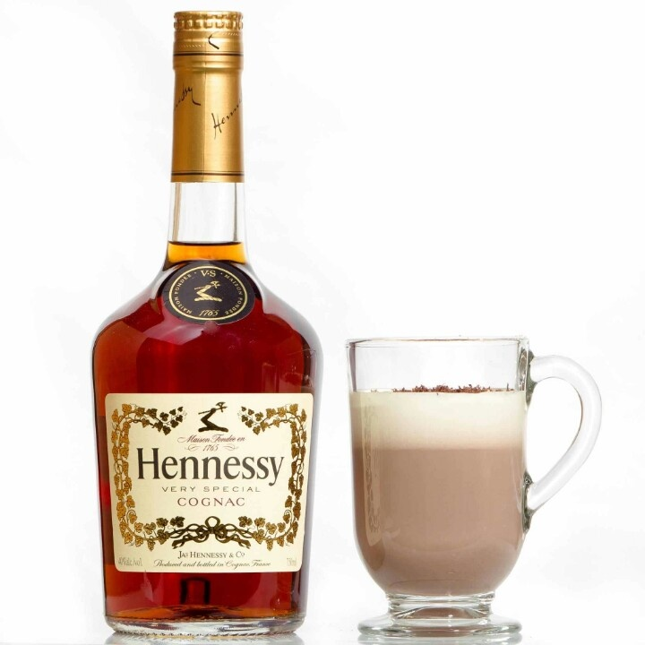 Snuggle up and get cozy with a Hennessy Coco, another classic holiday drink. Simply pour 1 ½ oz Hennessy V.S, 6 oz Hot Chocolate, ¾ oz Spiced Syrup, and 3 drops of pure Vanilla Extract into a heat-proof glass. Layer Heavy cream over the top to desired amount, and garnish with grated nutmeg and dark chocolate   www.jaxsprats.com