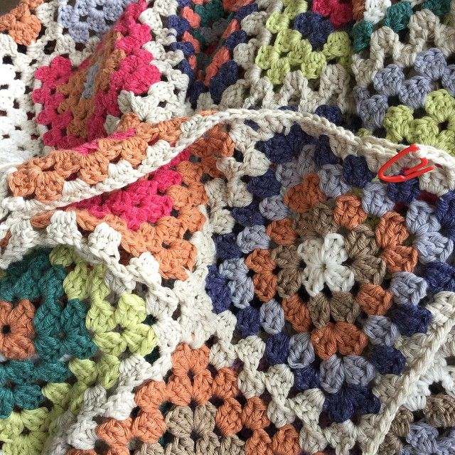 Random granny crochet square throw.   Made from Sirdar Simply Recycled Cotton Rich Aran (now discontinued). No square is the same. The colours remind me of the South Downs and Sussex coast where I live.