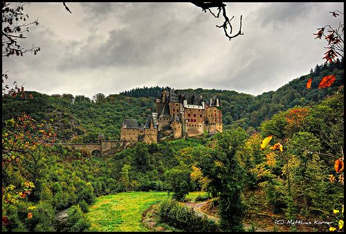 Burg Eltz  Burg Eltz is a medieval castle nestled in the hills above the Moselle River between Koblenz and Trier, Germany. It is still owned by a branch of the same family that lived there in the 12th century, 33 generations (about to be 34) ago. The Rübenach and Rodendorf families' homes in the castle are open to the public, while the Kempenich branch of the family uses the other third of the castle.
