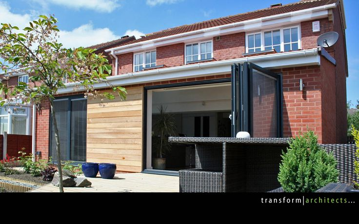 Contemporary lean-to with bi-folding door by transformarchitects.com