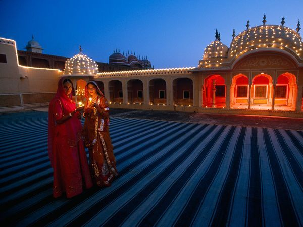 Two women in Jaipur hold candles to celebrate Diwali, or the Festival of Lights…. bf4b97ac4a1fc534e234344d62a4f975  diwali festival indian festivals