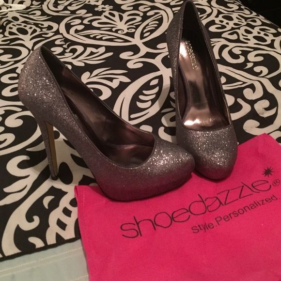 Sparkly pumps! Only worn once! Beautiful dark grey sparkly pumps! Very good condition! I do not have the original box but I have the protective Shoedazzle bag! Shoe Dazzle Shoes Heels
