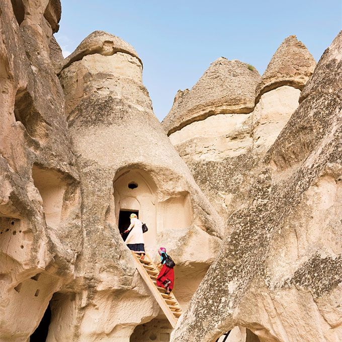 Cappadocia, Turkey   Picture a wild landscape of wind-sculpted rock spires and a network of mountain caves converted into churches, houses, and hotels and you'll get a sense of this Shire-like land. Set at the confluence of trading routes between Asia, Europe, and the Middle East, the region is influenced by them all. When you're ready to pick a perch, check in to Göreme's Anatolian Cave Hotel (doubles from ...