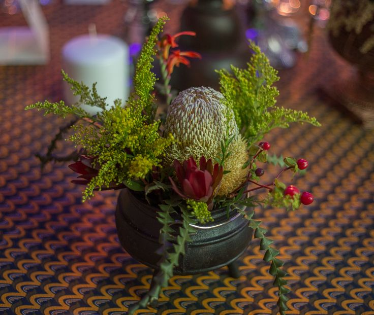 Nothing more eye-catching than a combination of South African fynbos for a table center piece.