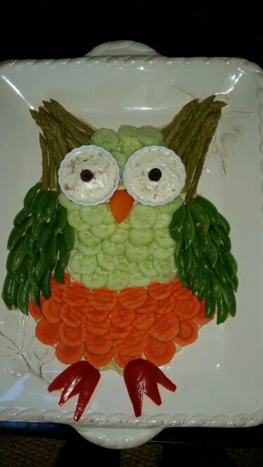 Owl veggie platter. So fun to make and a tip is to put humus down first to hold the veggies in place.