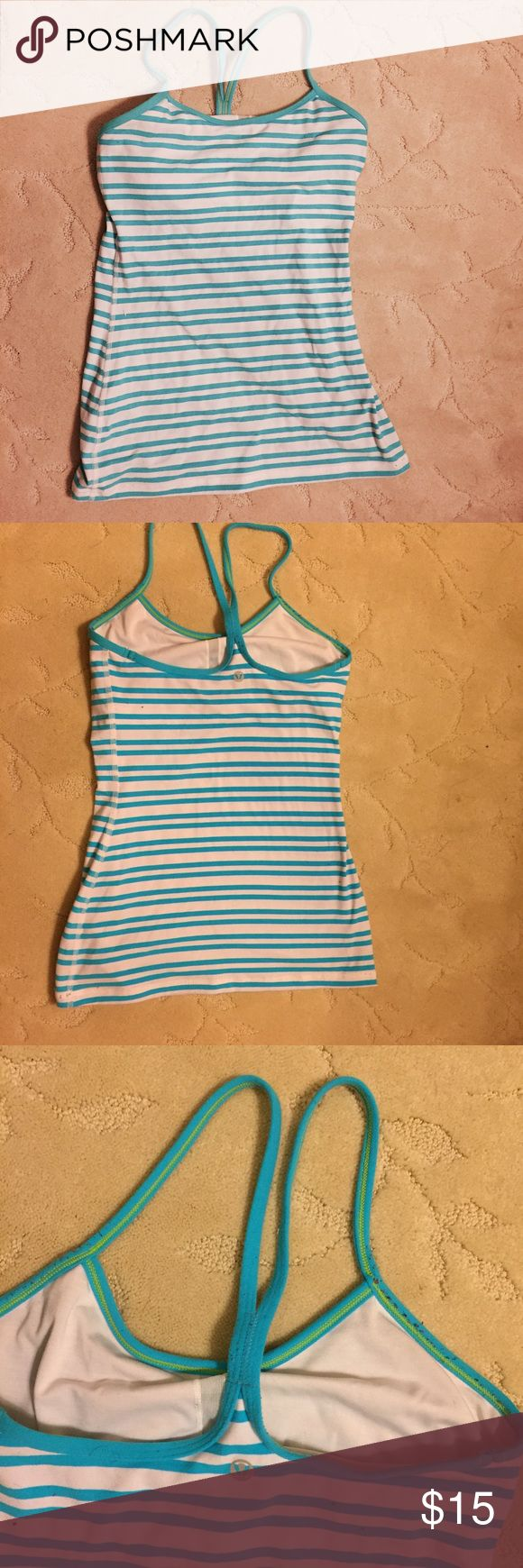 Lululemon striped tank top with built in bra Cute striped Lululemon tank top with a built in bra! I can send you cups with this if you are a 32D but otherwise if you use your own cups you can make it fit your bust better. lululemon athletica Tops Tank Tops