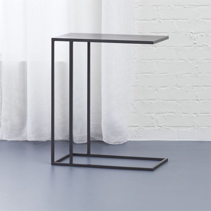Shop mill c table.   Cool c-table that pulls right up to the sofa or bed is welded heavy-duty but looks light on its feet.  Industrial iron with raw antiqued finish.