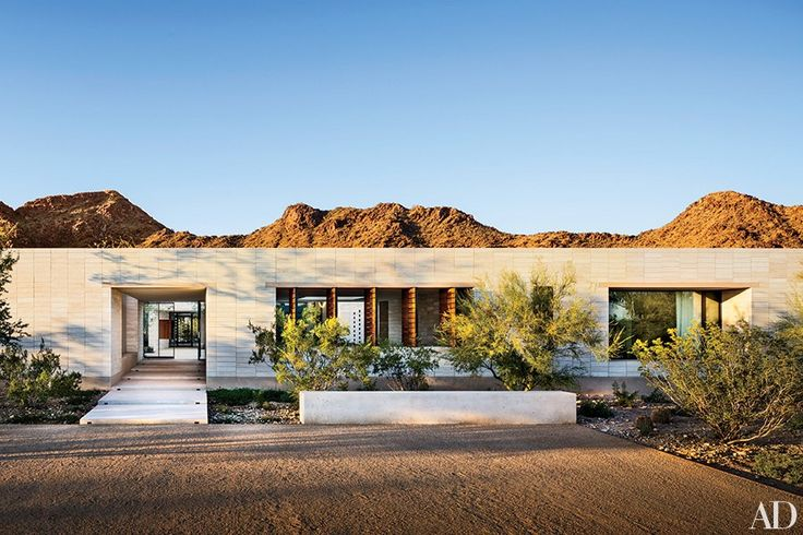Architect Marwan Al-Sayed designed this Phoenix residence, whose front façade, like most of the house's walls, is composed of limestone blocks.