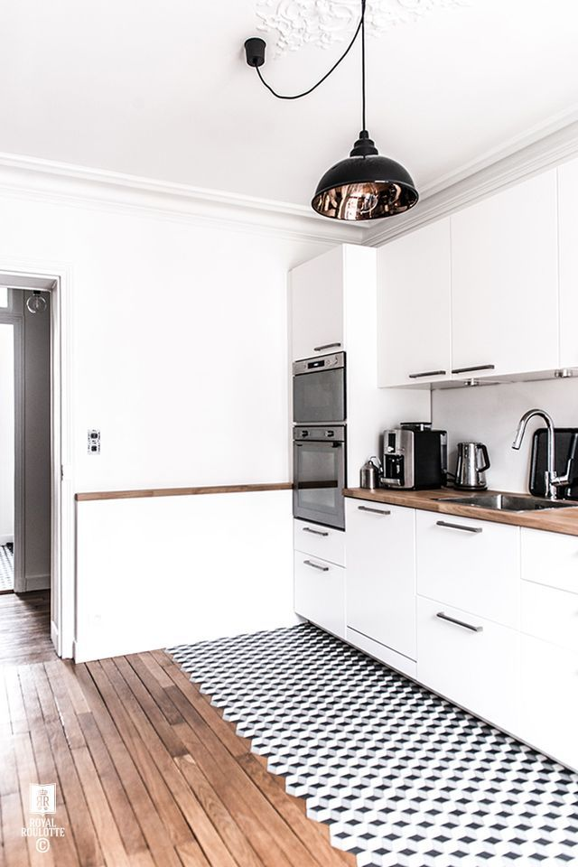 A beautiful white, minimal and modern Paris apartment, that has recently had a complete renovation by Royal Roulotte. An eye-catching use of cement tiles with a black and white graphic pattern, in the