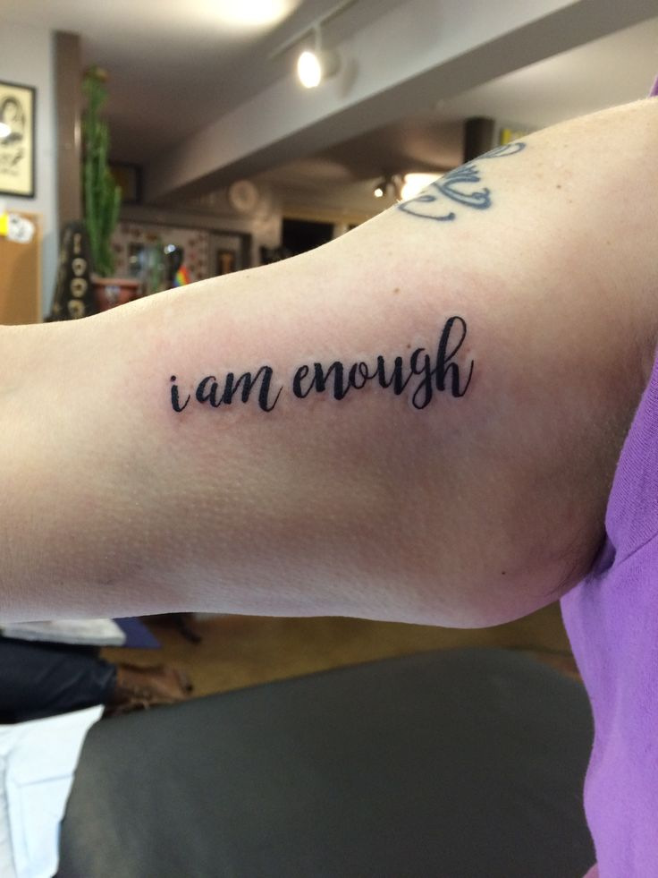 """""""I am enough"""" tattoo made by Kris Smith."""