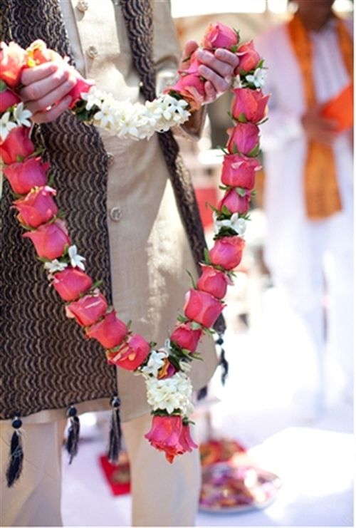 Check out this great Look I found on http://www.AsianBride.me #Garland #Milni #Bright Pink #White #Flora #WeddingInspiration