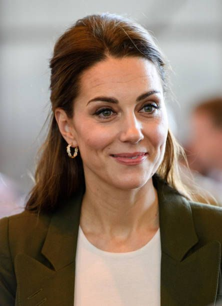 Catherine, Duchess Of Cambridge Speaks To Serving