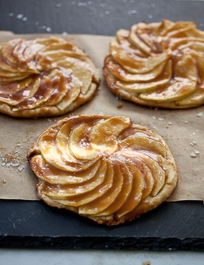 APPLE TARTLETS WITH SALTED CARAMEL - ¾ cup granulated sugar ¾ cup heavy cream ½ teaspoon fine sea salt 1 tablespoon butter FOR THE APPLE TARTLETS - 1 sheet frozen puff pastry dough 2 apples 1 tablespoon melted butter 4 teaspoons sugar Flaked sea salt or fleur de sel, for sprinkling