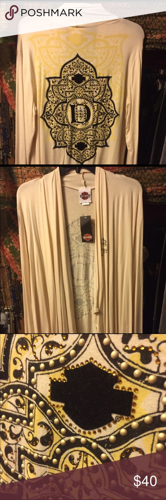Harley Davidson Cadigan. New. Beautiful ladies rayon/spandex blend cream Cardigan. New no tags. Never worn. Size is small/medium. Open front, no fasteners. Harley-Davidson Tops