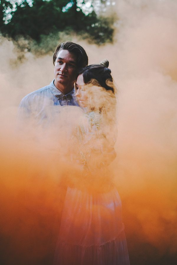smoke bomb - photo by Hello Miss Lovely http://ruffledblog.com/bohemian-love-shoot-in-the-woods #engagementsession #smokebomb