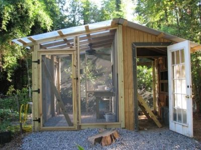 I must be in a chicken coop phase...but this one is a coop/greenhouse combo made of recycled, re-purposed, or salvaged materials.  And its awesome.