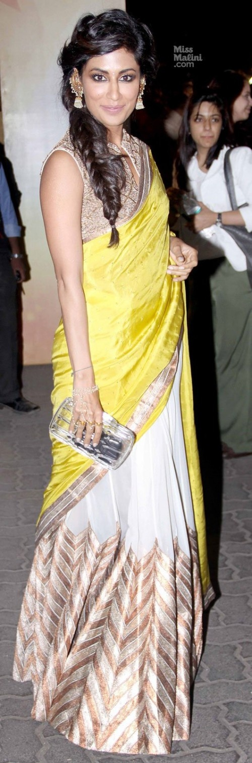 Chitrangada Singh in an Anand Kabra sari, Gucci clutch and Amrapali earrings.