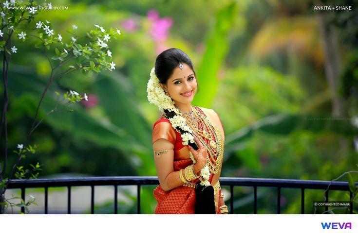 South Indian bride. Temple jewelry. Jhumkis.Red silk kanchipuram sari with stone work blouse.Braid with fresh flowers. Tamil bride. Telugu bride. Kannada bride. Hindu bride. Malayalee bride.Kerala bride