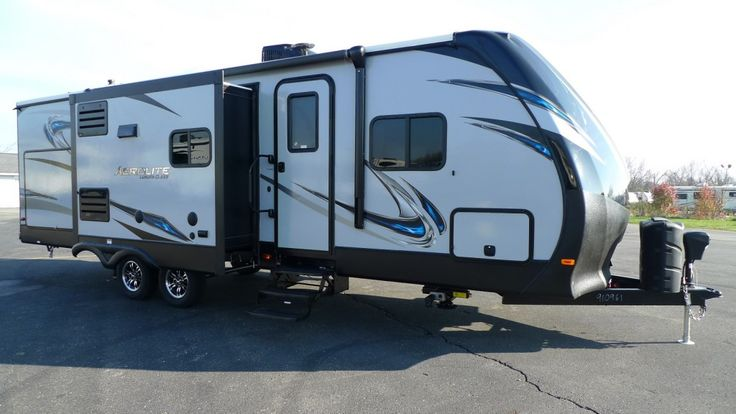 """LUXURY AT ITS PEAK. RVING AT ITS FINEST.  2017 Dutchmen Aerolite Luxury Class 272RBSS Sleep like royalty on your king-size bed found at the front of this 31' 9"""" long, 6776 lb. RV! With stainless steel appliances, you can be sure that your interior will coordinate with your own unique style and design tastes. Bring your favorite musicians along for the ride with the Bluetooth® stereo! Give our Aerolite Luxury Class expert Norman Wells a call 231-730-3481 for pricing and more information."""
