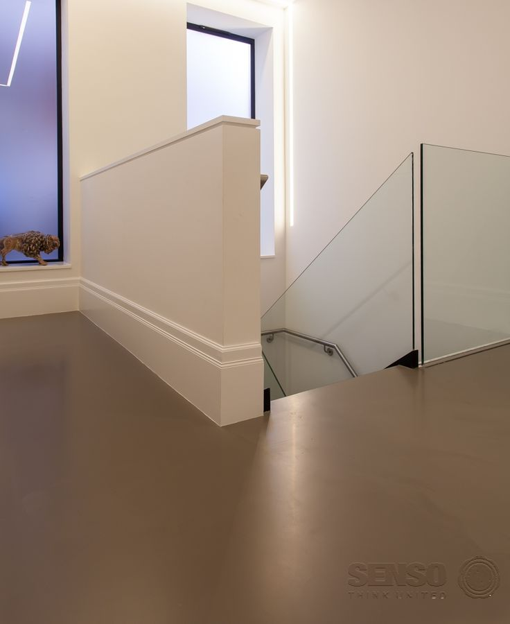 Senso resin flooring - available in any bespoke colour, to complement or contrast with the rest of the design.