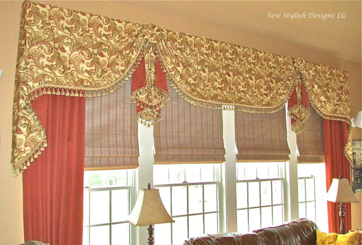 Dressy casual Moreland valance with paisley fabric and panel drapes in family room