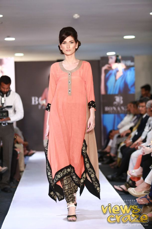 Abeer Adeel walks the ramp for Maheen Karims Pret ensemble