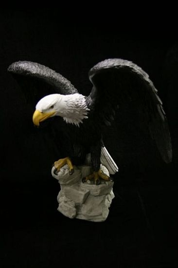 Large Bald Eagle Statue in Color - This large bald Eagle has beautiful color and great detail. Made from bonded Italian marble and a solid cast this piece has some way to it will stay put. Bonded marble items are sought after primarily for their rich detail and craftsmanship. This is a large piece at 26 inches long and 26 inches tall with a depth of 17 inches. A large and magnificent piece of our national bird.