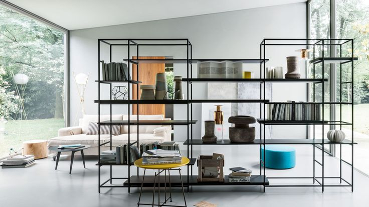 Plain bookshelf, designed by Francesco Rota for Lema is modular, lightweight and elegant, with free-standing squared metal structure and lacquered finish shelves.