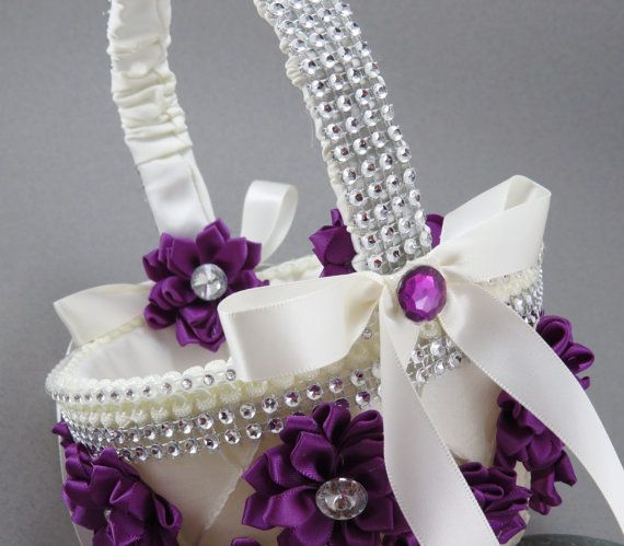 Check out this item in my Etsy shop https://www.etsy.com/listing/156572033/purple-flower-girl-basket-glitzy-flower
