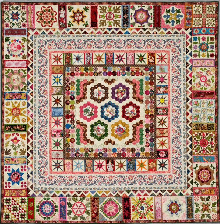 """ Turkish Tiles"" is inspired by 2 antique quilts, Anna Brereton, early 1800's in Britain for the hexagon centre of the quilt and for the borders, Charlotte Gillingham of Philadelphia 1842. Hand appliqued, hand pieced and hand quilted. There are some lovely toile fabrics and chinz.Reproduction fabrics on muslin background. No pattern, but see QNM#377 November 2005 for some blocks which QNM had drawn."