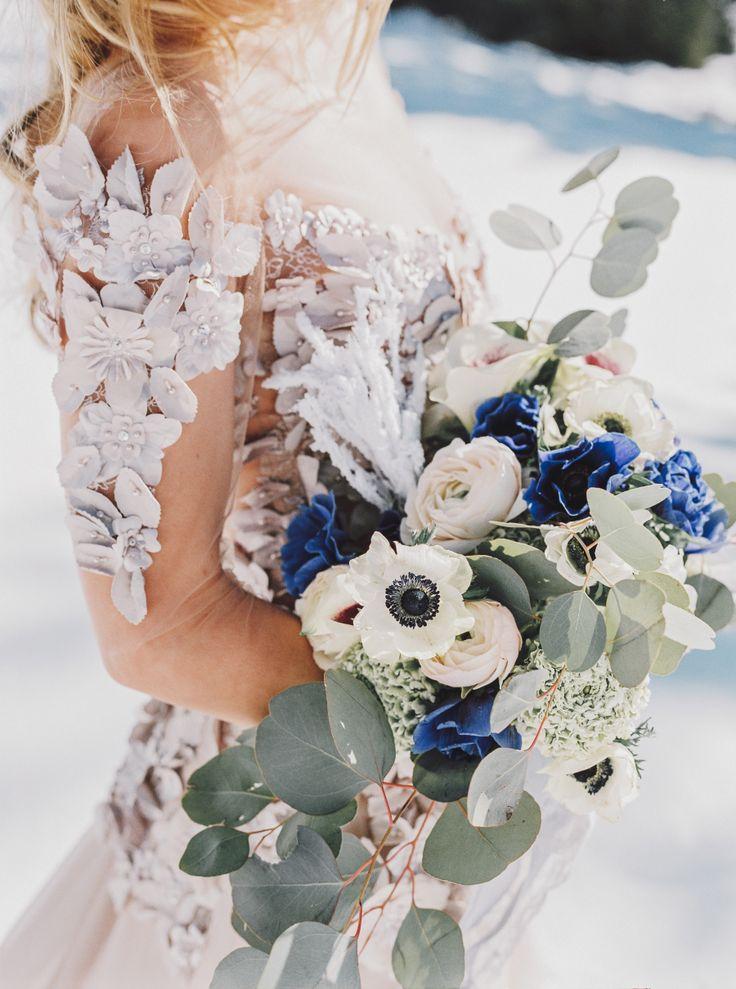 Anemone and eucalyptus wedding bouquet: Floral Design: Blumen and Sterne - http://www.instagram.com/blumenandsterne Wedding Dress: Mery's Couture - http://www.merys.com Photography: Anna Tereshina Photography - www.tereshina.com   Read More on SMP: http://www.stylemepretty.com/destination-weddings/2017/05/17/winter-switzerland-bridal-session/