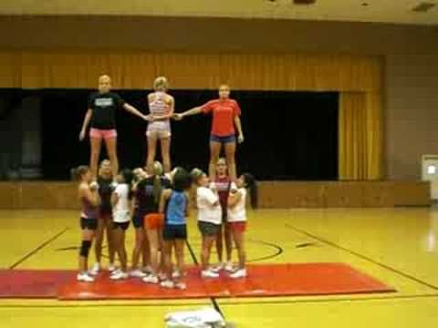 Fossil Ridge Cheer Pyramid - YouTube.  My girls would LOVE this one, and it looks so easy!  :o)