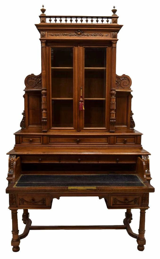 """French mahogany bureau bookcase, late 19th c., a galleried finial accented crest rail over two glazed doors, with flanking columns, opening to shelves, the lower pat with a drop front pull out leather writing surface with a three drawer gallery, four lower exterior drawers, one with locking box, all rising on stretcher joined bun foot turned legs, approx. 89""""h, 50""""w, 26""""d"""