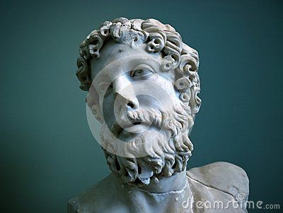A portrait shot of an ancient Greek statue against green background, shot at a museum in Copenhagen, Denmark.