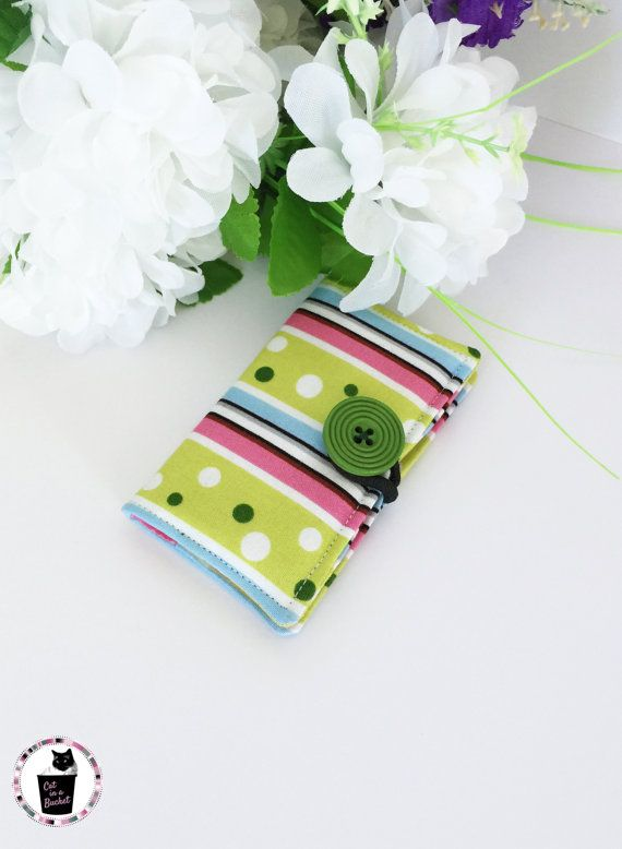Dots and striped are sure to add a bit of fun to your bag! This card holder is perfect for business cards, credit cards and more
