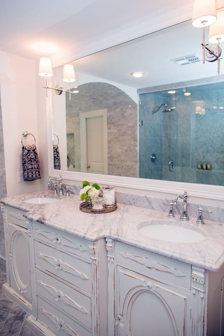 antique dresser used as a bathroom vanity in Fixer Upper home