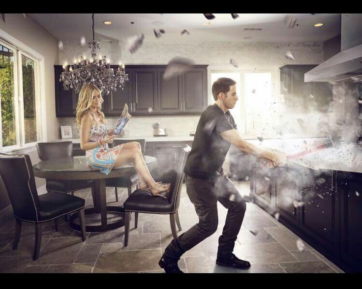 Awesome picture of tarek demoing the kitchen christina for Flip this house host