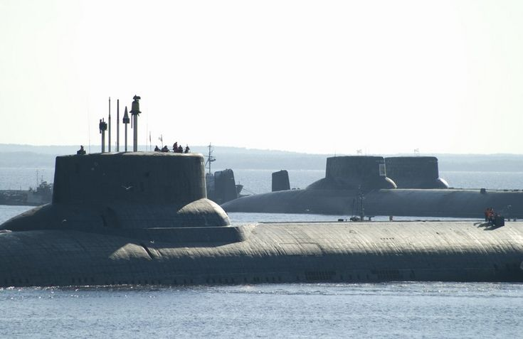 """On June 9,Russian Typhoon class SSBN """"Dmitri Donskoi"""" left iport for mission at sea.Moored in harbour,were 2 others of same class.Typhoon class SSBNs (Soviet code: 941 Akula) largest submarines of former Soviet Union,also largest in world.6 built in total,but after collapse of Soviet Union,3 dismantled.In future,Russian Navy will replace them with """"Borei"""" class for its strategic nuclear deterrence forces."""