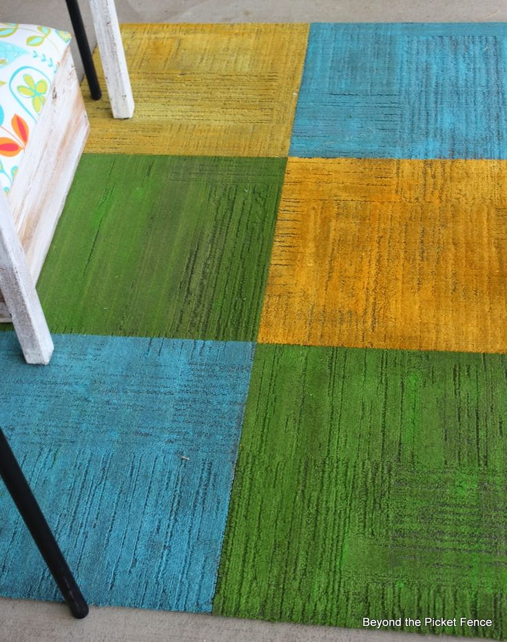 Cheap carpet squares painted & duct taped together for an outdoor rug