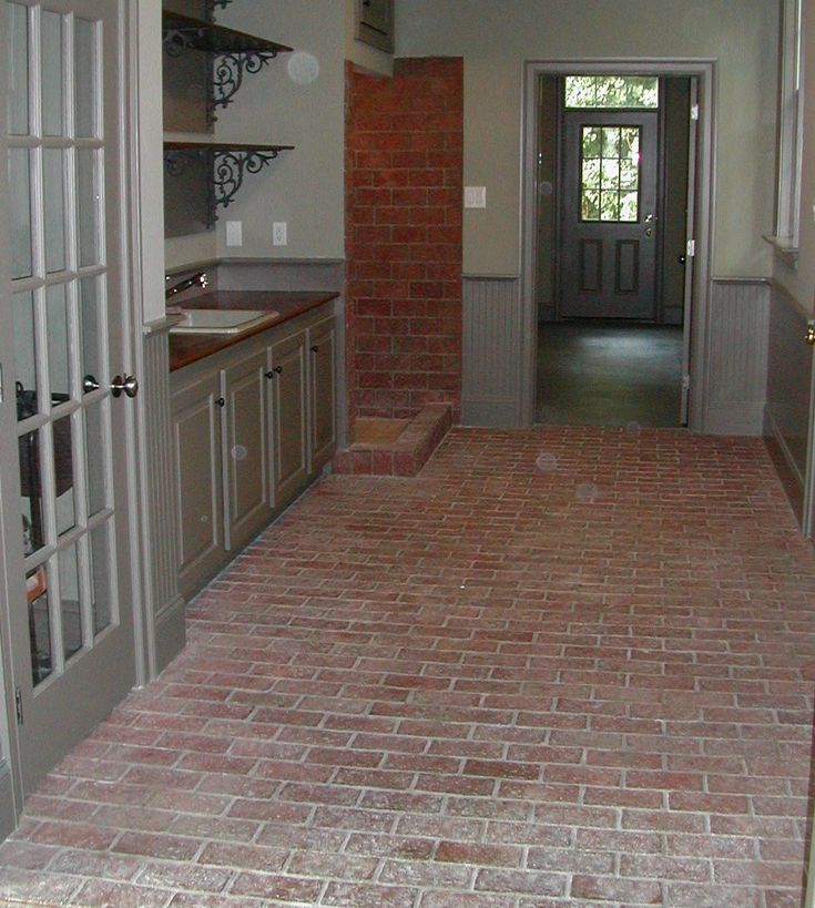 Brick floor mudroom with sink shower and storage folks for Mudroom floors