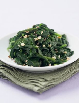 Spinach   Iron is also necessary to deliver oxygen to your cells, which they need for energy and to burn fat. For women, the recommended daily allowance of iron is 18 mg, and simply adding a side of cooked spinach to a meal offers 6 mg. Squeeze a vitamin-C-rich lemon over a cup of steamed spinach to help your body better absorb the mineral.