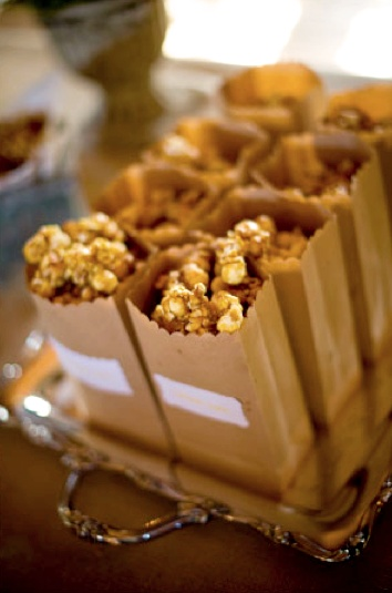 brown bags full of caramel popcorn party event entertaining wedding autumn fall by style me pretty