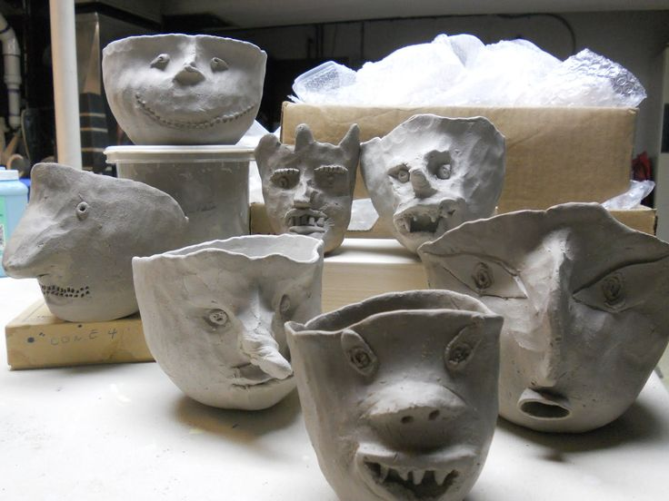 Fun pinch pots ready for planting wheat or rye grass to grow some hair.