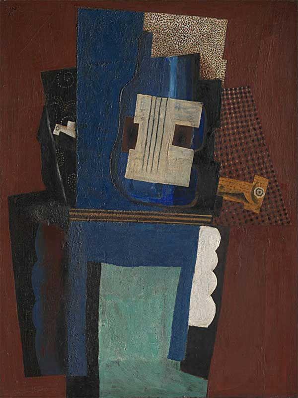 Картина Пабло Пикассо. Гитара и кларнет на камине. 1915