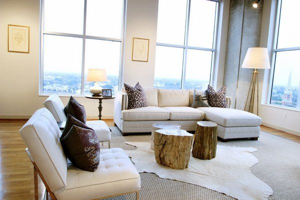 Contemporary living room decorating ideas white cowhide area rug wood trunks
