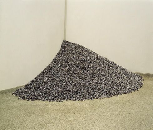"""Untitled"" (Public Opinion), 1991. Black rod licorice candies individually wrapped in cellophane, endless supply, ideal weight: 700 lbs (317.5 kg)"