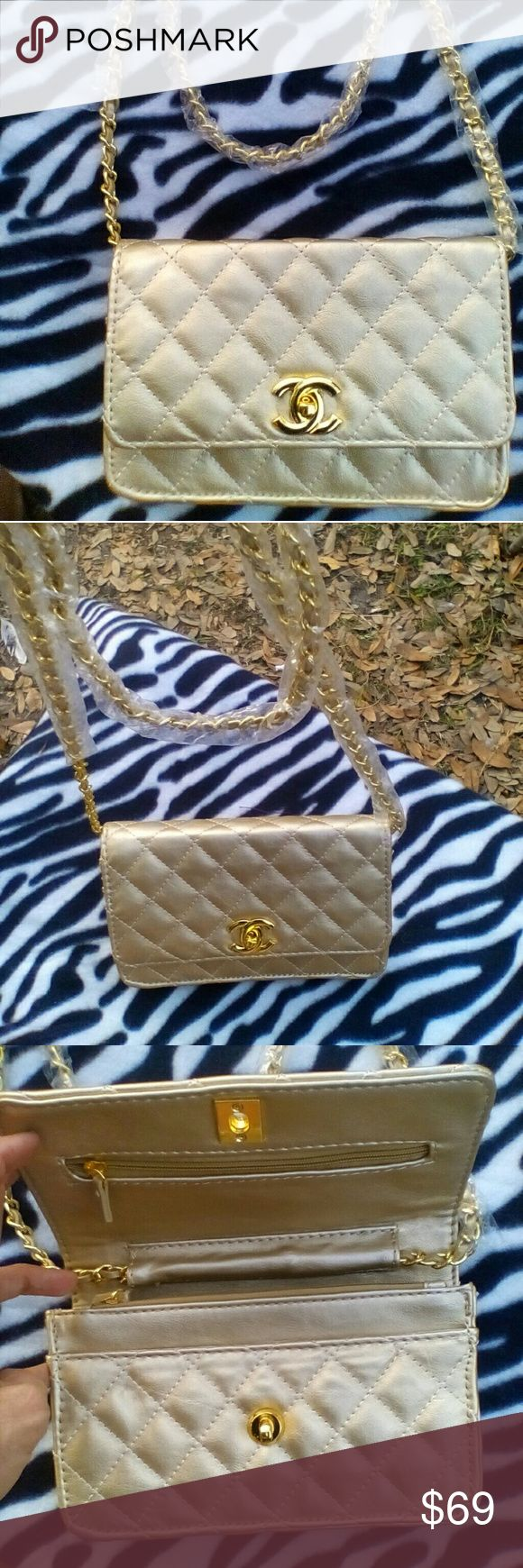 NWOT Gold C.hanel Mini Quilted Bag NWOT CUTE Chanel Mini Quilted Shoulder Bag. Chain Shoulder Strap still has plastic on it. Beautifully designer inspired. Price reflects auth.  Shop my closet for more deals. Bundle and save. Happy Poshing! Bags Shoulder Bags
