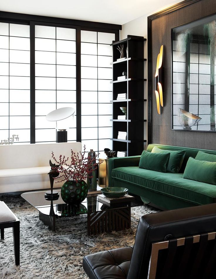 Emerald green velvet sofa of dreams, come to Mama! A little too much black here for my taste, but the sofa and black trimmed windows from floor to ceiling (that look almost like huge Shoji screens), definitely YES!